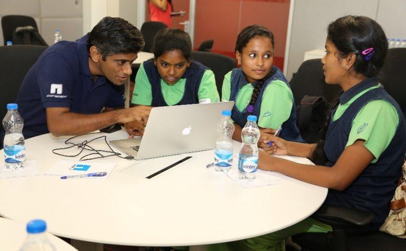 volunteers helping Parikrma students